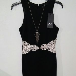 NWT Elegant black sleeveless dress. Sale now !!