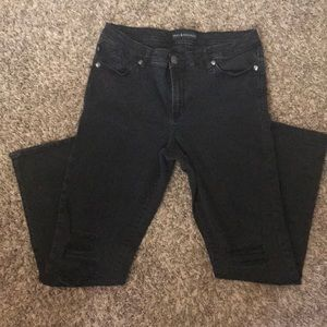 Faded, ripped black denim jeans