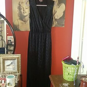 Long black shimmery dress.