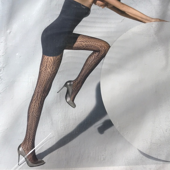 144222e4689 Wolford peacock net tights