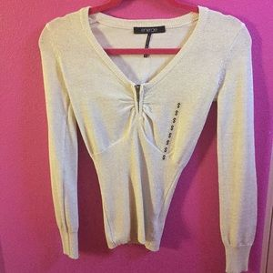 Fitted light gold cream holiday top.
