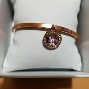 Michel Kors rose colored bangle