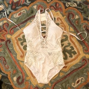 white cut out one piece bathing suit
