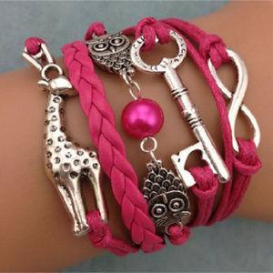 NWOT Dark Pink/ Rose Color Bracelet with Charms
