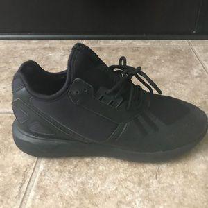 Triple Black Adidas Tubulars.