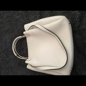 Hire sleek vegan purse