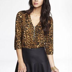 Animal print vneck blouse with zipper