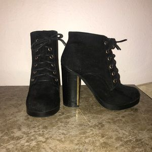 Black booties with gold hardware
