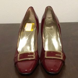 Red Guess patent leather heels.