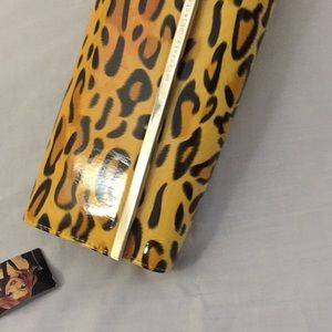 Necessary objects leopard print clutch purse. NWT