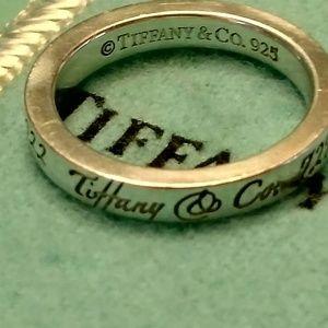 Tiffany & Co address ring.