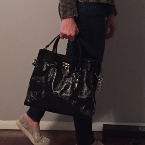 Michael Kors black patent handbag.