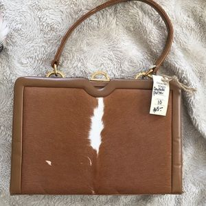 Vintage cowhide purse with vintage purchase price!