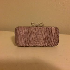 Lavender clutch with sparkle bow detail