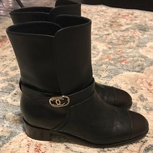 Quilted black Chanel boots with brown toe caps