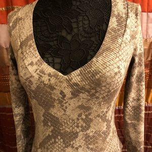 Gently worn V neck sweater