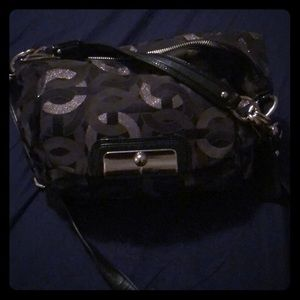 Black and silver coach crossbody