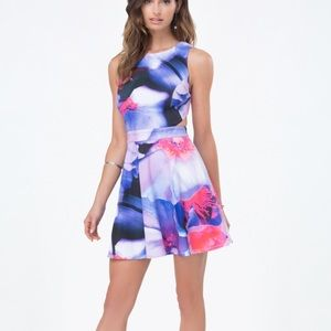 """Bebe """"Chrystal Bloom"""" dress with cut outs"""