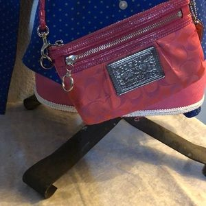Pink and silver coach cross body bag