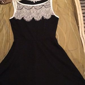 Black dress with white lace around the neck