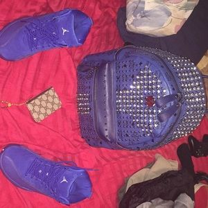 Mcm backpack, deep royal 12's, and Gucci Zip pouch