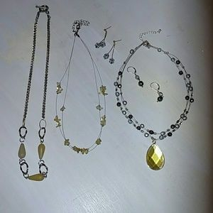 3 necklaces and 2 pair of earrings