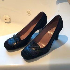 Stacked Nine West heels.