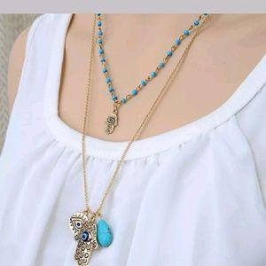 New double Hamsa Tourquoise necklace