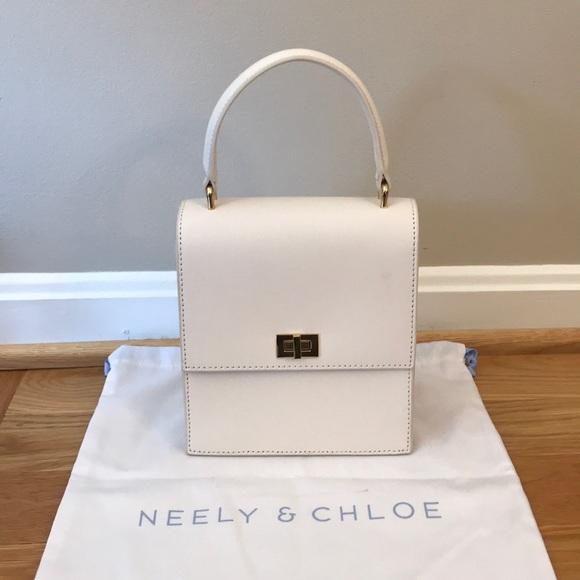 ac8f130f36a2 Neely   Chloe No. 19 The Mini Lady Bag Saffiano. M 5a16fd152de512cb6202efa1