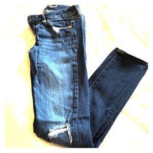 Distressed denim stretch skinny jeans