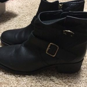 Steve Madden black boot with gold buckle