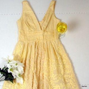 B. Darlin cream brocade spring dress