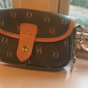 Black Dooney & Bourke wristlet with colorful DBs
