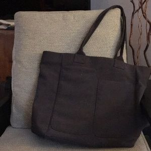 gray tote bag with huge outside pockets