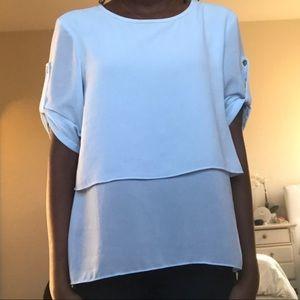 A light blue Calvin Klein top