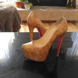 Christian Louboutin cork heels 100% authentic.