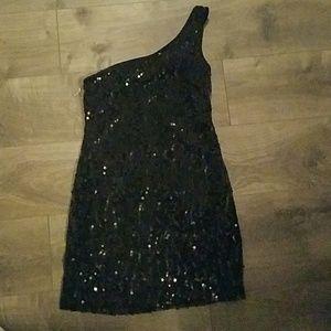 Black shimmery dress.