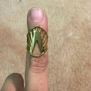 Gold ring im not sure of the designer SORRY