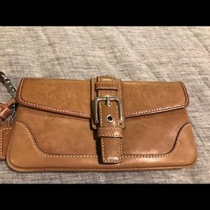 Well loved Coach wristlet Brown