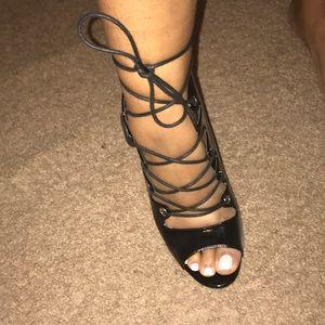 Black strap up heels