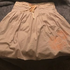 Tan skirt with orange and yellow ribbon