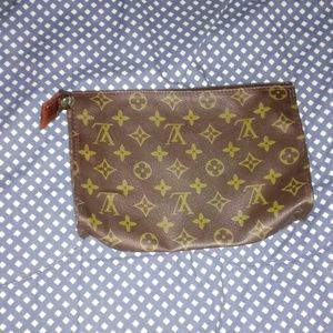 Vintage Louis Vuitton clutch