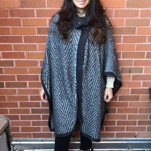 Grey knitted cape from The Outnet