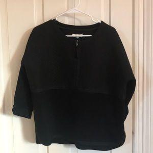 A black half-zip madewell pullover