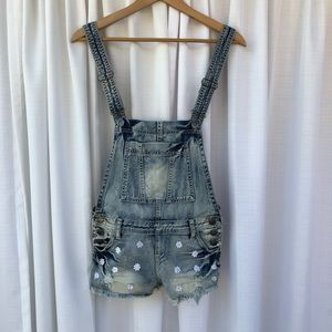 Pants - Super cute daisy cut off overalls.