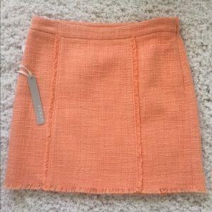 light orange color skirt.