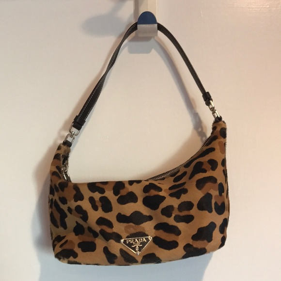 da7da81514fe Prada cowhide leopard print bag. 9in widex5in tall.  M_5a186ec46d64bc7f92077b86