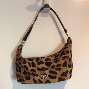 Prada cowhide leopard print bag. 9in widex5in tall