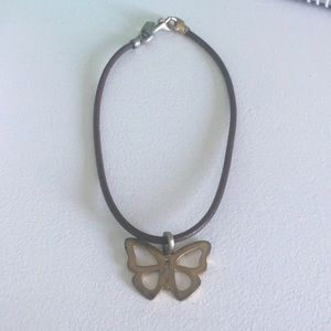 Worn Coach butterfly necklace