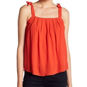 ASTR label orange red tank with bows
